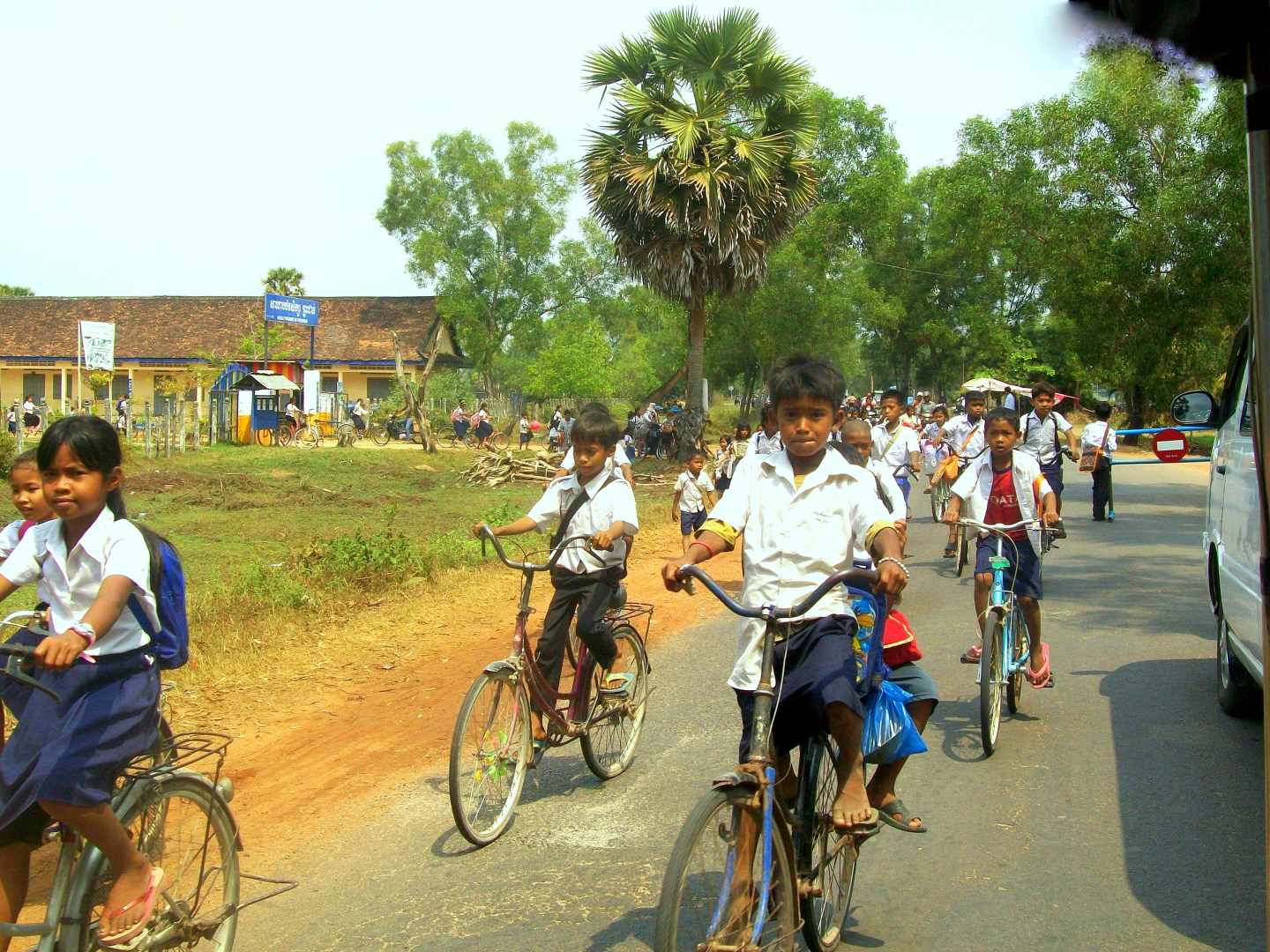School children on the road between Luang Prabang & Banteay Srey outlying temple = Cambodia