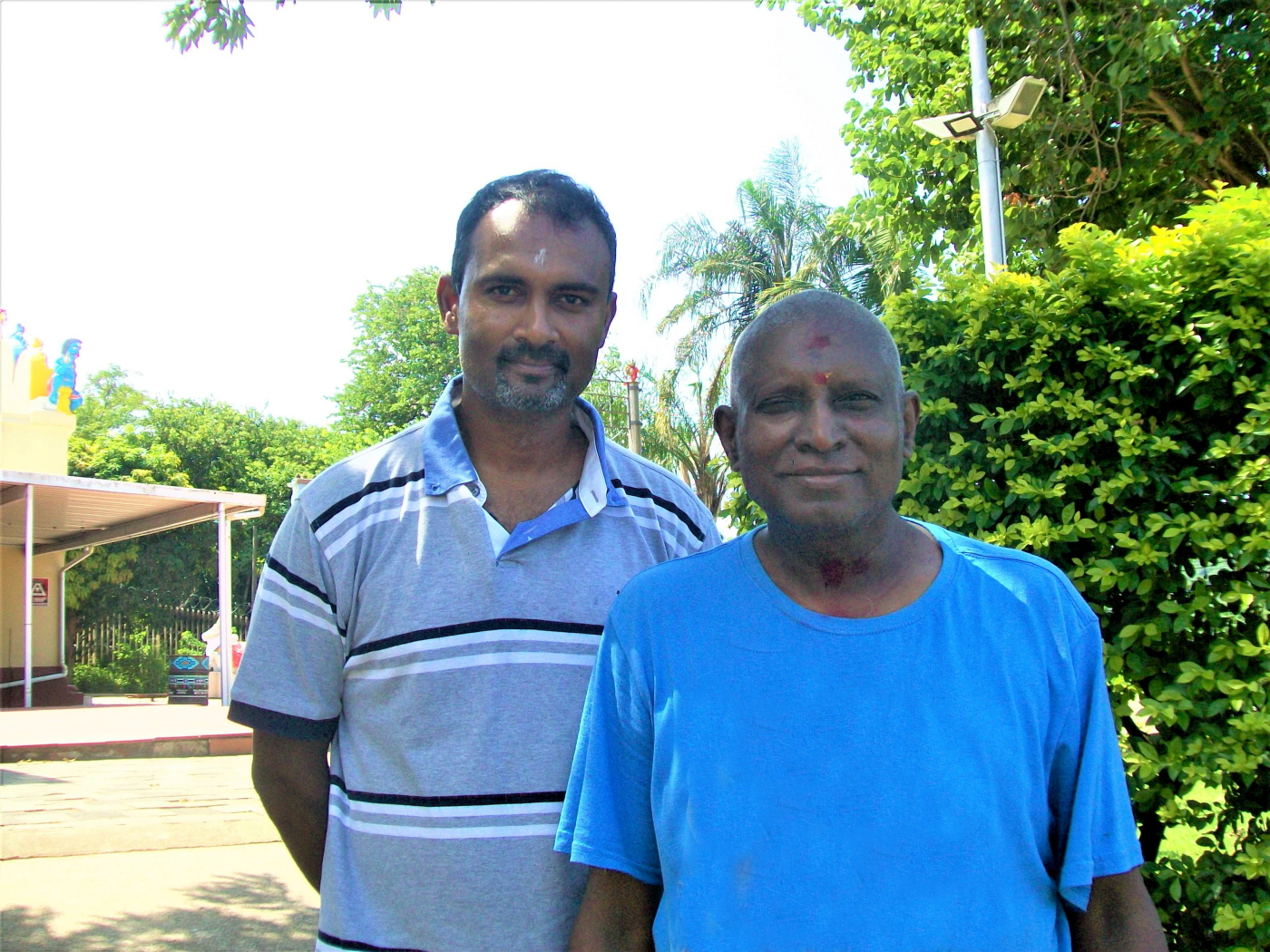 Guruji Dhanasagren Govender - Spiritual Leader of Umbilo Shree Amvalavaanar Alayam (Right) & Theshin Naicker the Embrace Founders Kind Guide (Left)