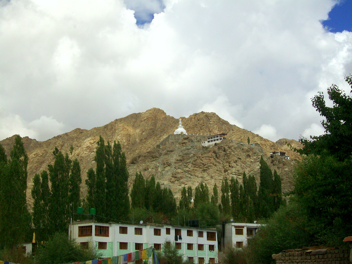 Stupa Gompa (Monastery) on Mountain - a hotel below - Leh, Ladakh- India